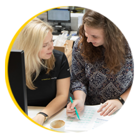 women working in project management for Ecommerce products for Chicago food co-packer manufacturer