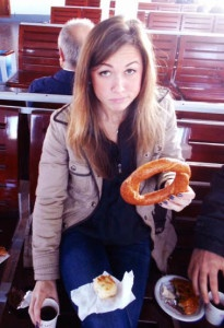 "Amanda enjoying ""simit"" and börek while aboard a sea bus in Istanbul, photo credit goes to her Turkish friend whom she visited nearly a year ago."