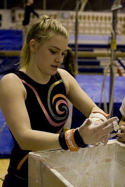 Jordan chalking up for a gymnastics session in high school.